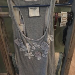 Beautiful tank with flowers snd sequins